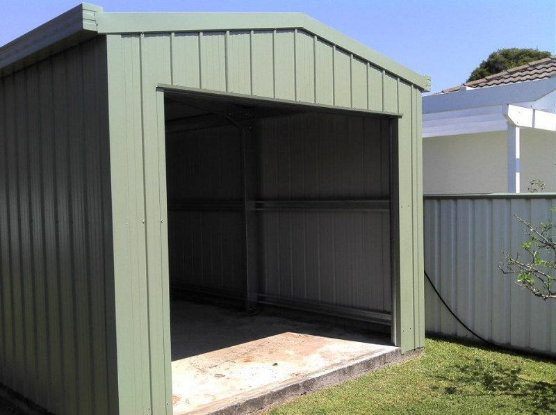 Golf cart shed or garage park the cart in style steel for Golf cart garage door dimensions