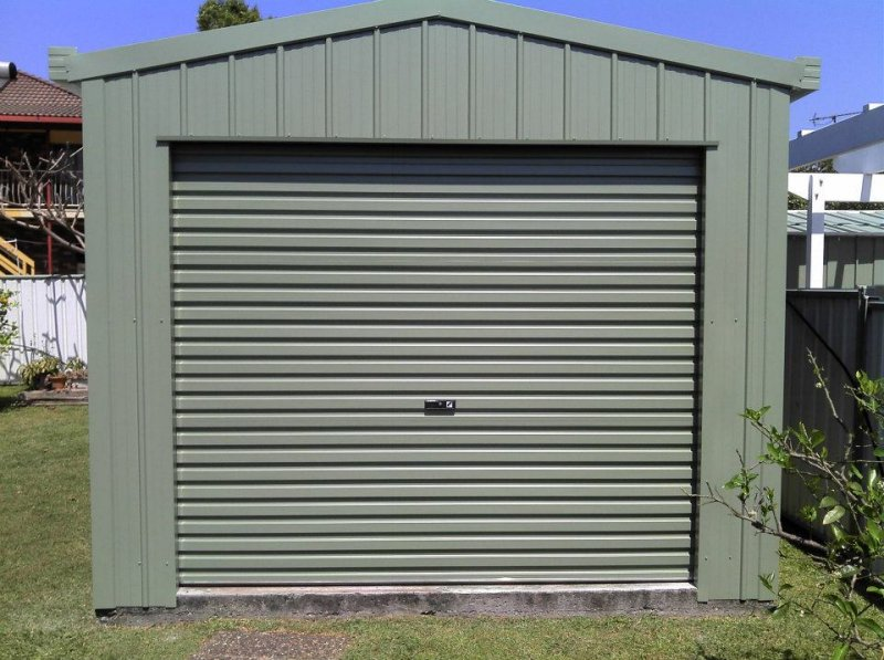 Golf cart shed or garage park the cart in style steel for Golf cart garage door