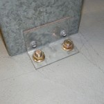 Simple on slab bracket with sleeve anchor fixing