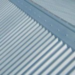 buy roll top ridge capping on a corro or custom orb roof in zincalume